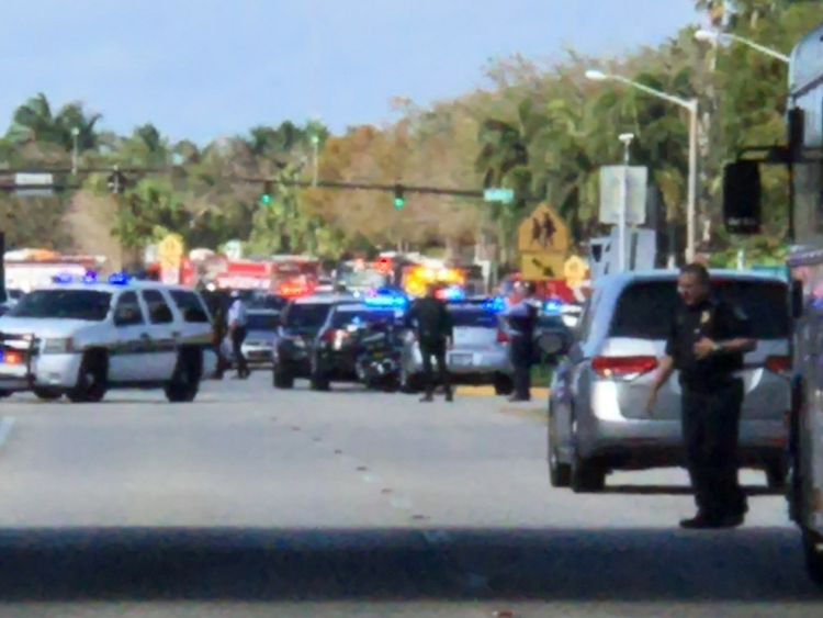 Police cars are seen in Coral Springs after a shooting at the Marjory Stoneman Douglas High School in Parkland, Florida, U.S. February 14, 2018 in this image obtained from social media. CREDIT: @GRUMPYHAUS