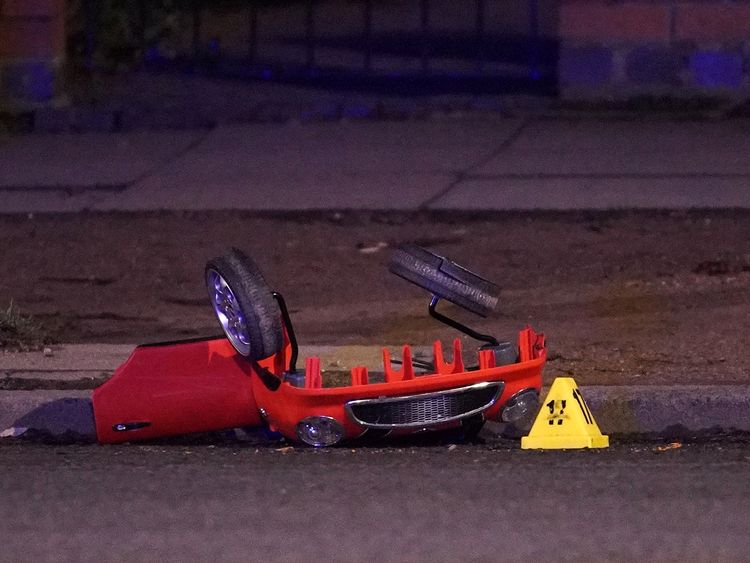 The remains of a toy car is marked by police accident markers