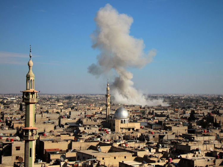 Smoke rises from buildings following government bombardment on the outskirts of the capital Damascus
