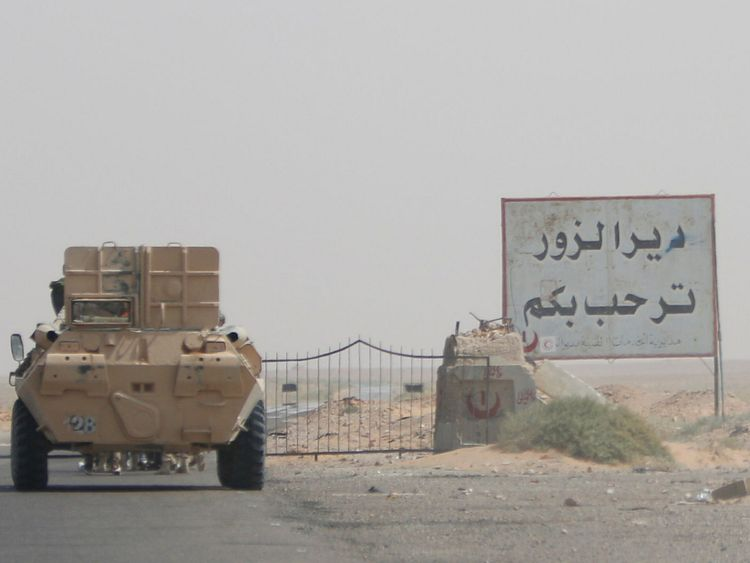 A road sign welcomes people to the town of Deir al-Zor in Syria