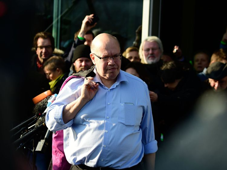 Peter Altmaier of the Christian Democratic Union (CDU)  leaves after the all-night talks