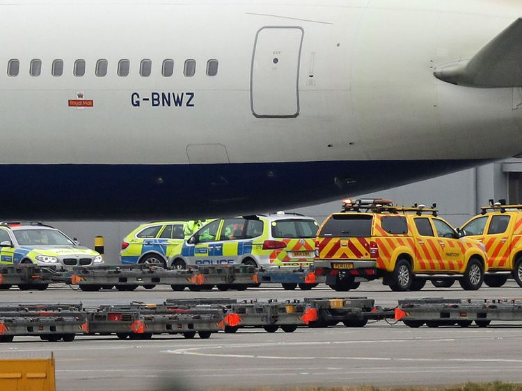 Police and airside operations vehicles at Heathrow Airport after a man died following an accident on the airfield