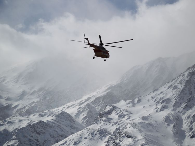 Emergency and rescue helicopter searches for the plane that crashed in a mountainous area of central Iran, February 19, 2018