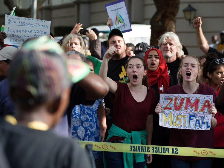 Demonstrators call for Zuma's removal outside the home of the controversial Gupta family
