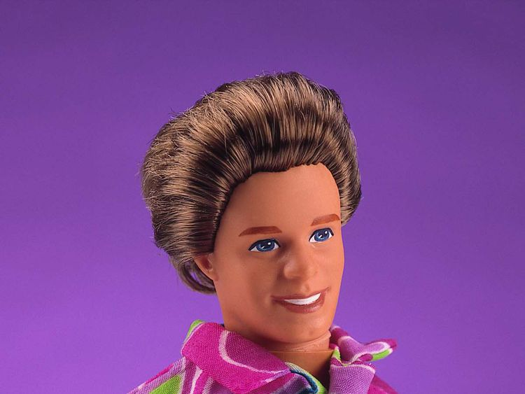 1992 Total Hair Ken doll wears a multi-colored patterned shirt in this studio portrait. On March 13, 2001, Mattel toy company celebrated the 40th anniversary of the Ken doll which was originally introduced March 13, 1961 at the American International Toy Fair. Originating with his crew cut look and evolving through the funky disco styles of the ''70s and ''80s, to the trendy styles of the ''90s, Ken has been a worldwide pop culture favorite for every era and for several generations. (Photo cour