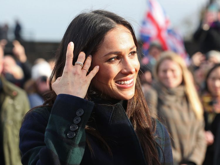 Britain's Prince Harry's fiancée US actress Meghan Markle smiles as she meets members of the public during a walkabout on the Esplanade at Edinburgh Castle, during a visit to Scotland on February 13, 2018. / AFP PHOTO / POOL / Jane Barlow (Photo credit should read JANE BARLOW/AFP/Getty Images)