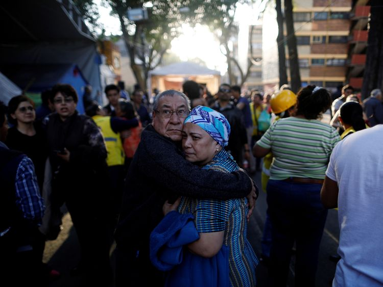 People react after an earthquake shook buildings in Mexico City, Mexico February 16, 2018