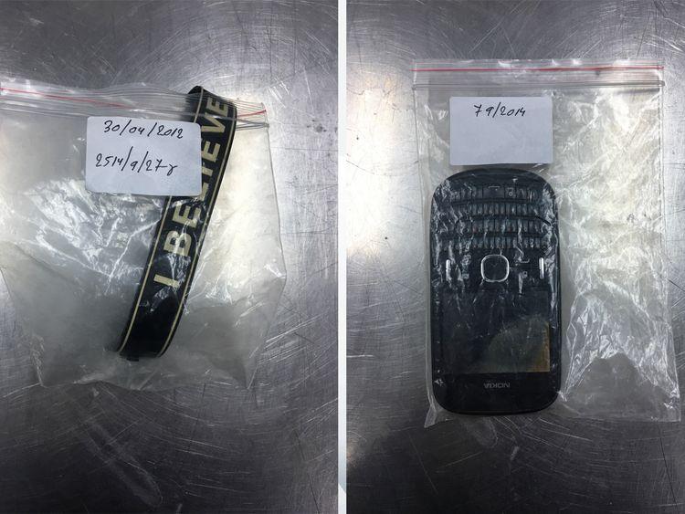 A 'believe' wristband; a phone