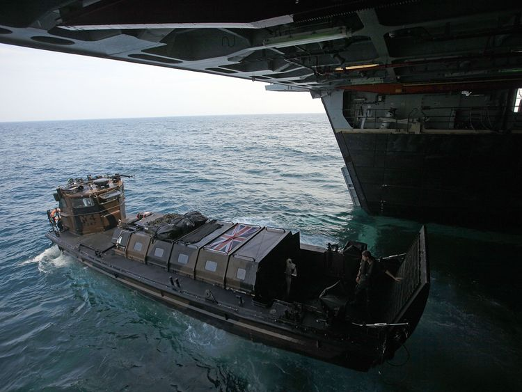 A Royal Marine landing craft births on HMS Albion during an exercise in 2010