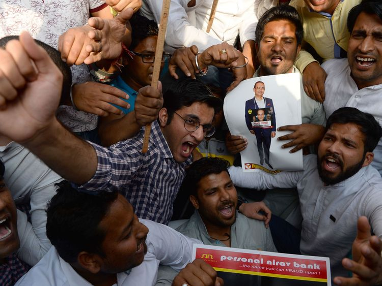 Congress Party supporters protest about Nirav Modi and India's Finance Minister Arun Jaitley