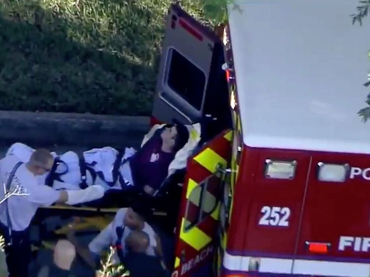 A man who was placed in handcuffs by police is loaded into a paramedic vehicle after a shooting incident at Marjory Stoneman Douglas High School in Parkland, Florida, U.S. February 14, 2018 in a still image from video. WSVN.com