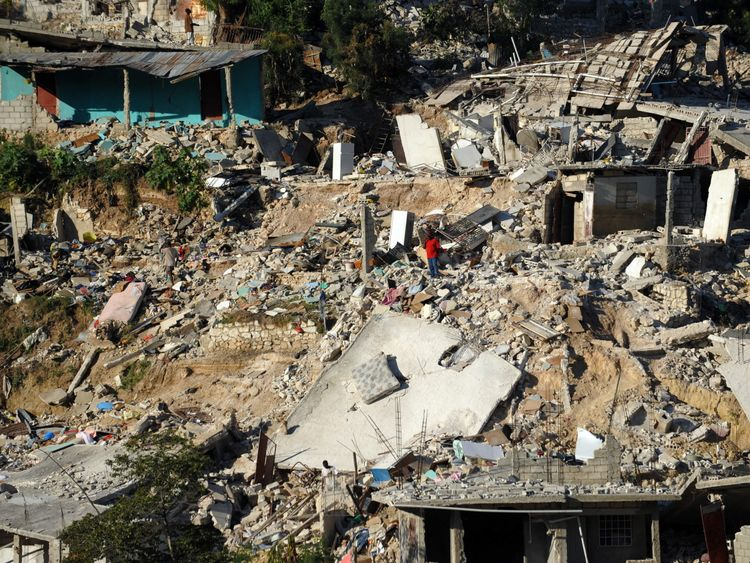 A man searches through the rubble in Port-au-Prince on January 18, 2010 after the country was rocked by a massive 7.0-magnitude quake