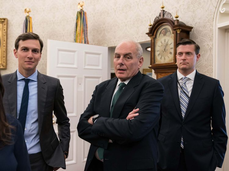 Jared Kushner (L), White House chief of staff John Kelly (C) and White House staff secretary Rob Porter