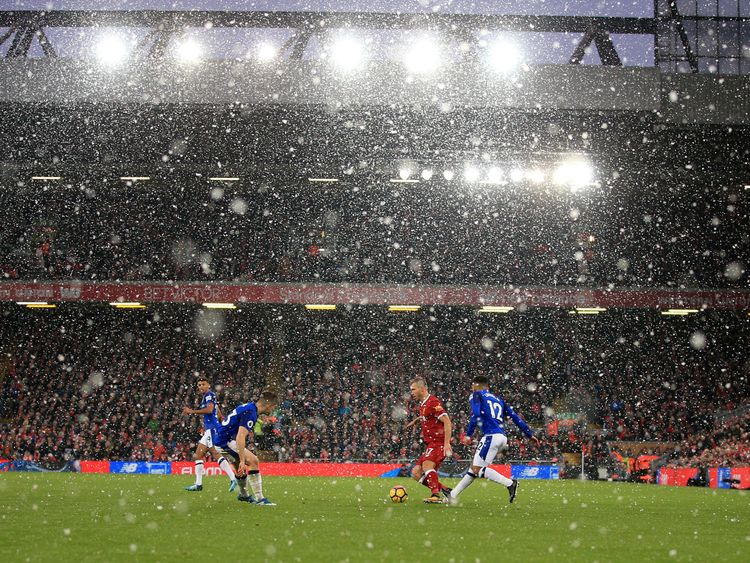 "Snow falls during the Premier League match at Anfield, Liverpool.  Peter Byrne/PA Wire/PA Image. EDITORIAL USE ONLY No use with unauthorised audio, video, data, fixture lists, club/league logos or ""live"" services. Online in-match use limited to 75 images, no video emulation. No use in betting, games or single club/league/player publications."