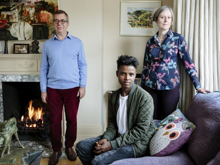 Charles and Katharine Elliott host young Ethiopian Hussein. Pic. UNHCR/Aubrey Wade