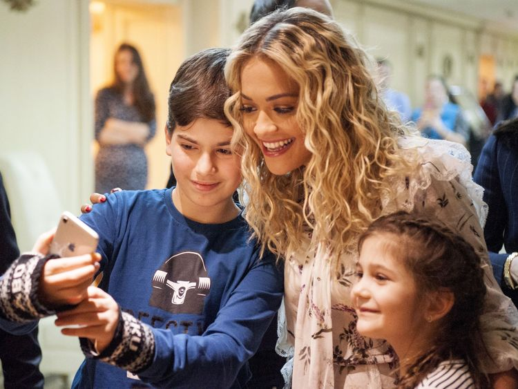 The singer's young fans were keen to grab a selfie upon her arrival