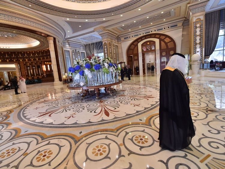 US and Saudi officials walk in the hallway of the Ritz Carlton hotel in the capital Riyadh on May 21, 2017, during a visit of the US president. / AFP PHOTO / GIUSEPPE CACACE (Photo credit should read GIUSEPPE CACACE/AFP/Getty Images)