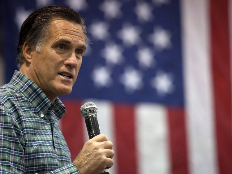 Former Massachusetts Gov. Mitt Romney addresses the crowd during a rally for Republican Senate candidate Dan Sullivan at a PenAir airplane hangar on November 3, 2014 in Anchorage, Alaska