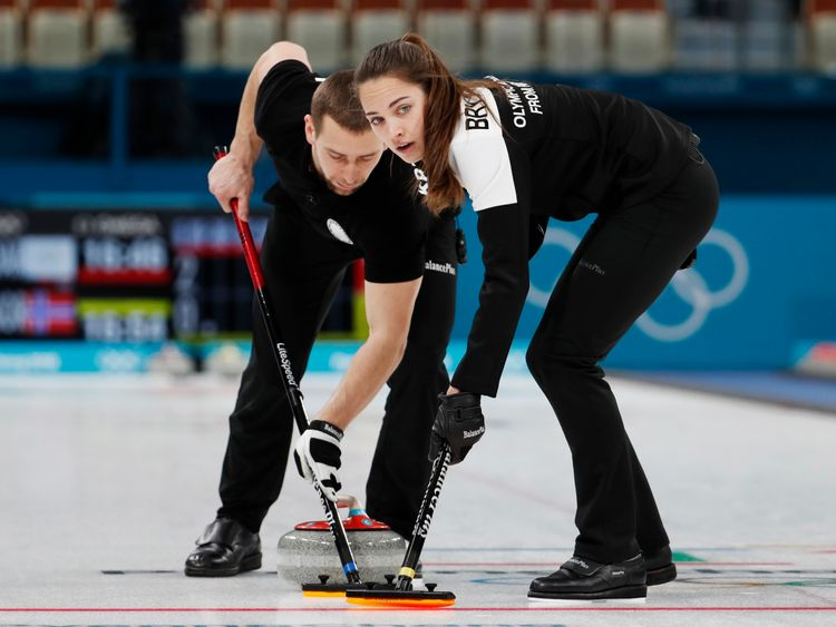 Alexander Krushelnitsky and Anastasia Bryzgalova in action in the mixed doubles bronze medal match