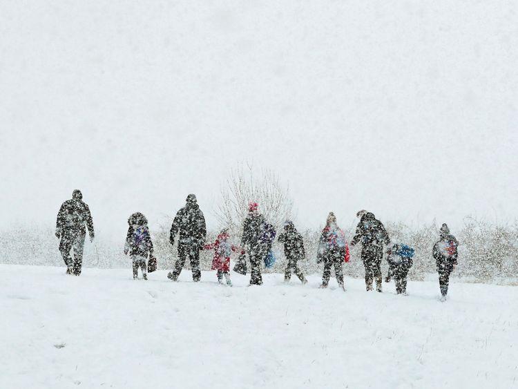 Parents walk their children to school in Ashford, Kent