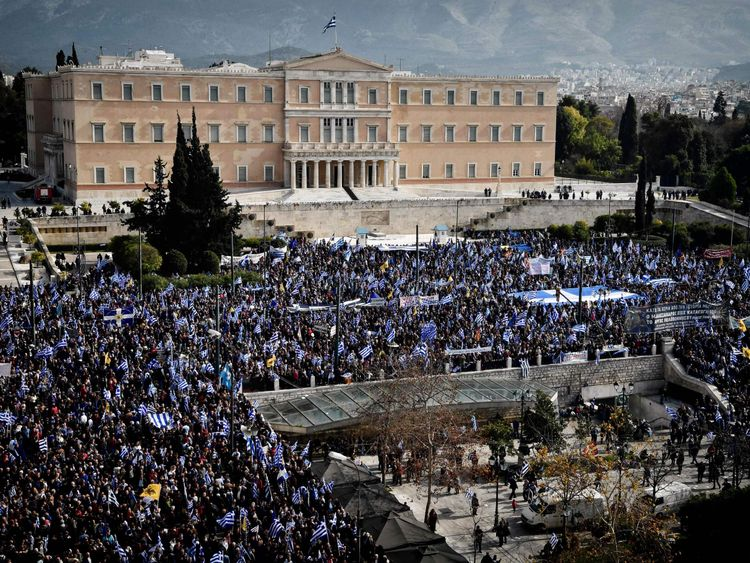 People demonstrate to urge the government not to compromise in the festering name row with neighbouring Macedonia, in front of the parliament of Greece, located in the Old Royal Palace (background), at the Syntagma Square in Athens, on February 4, 2018