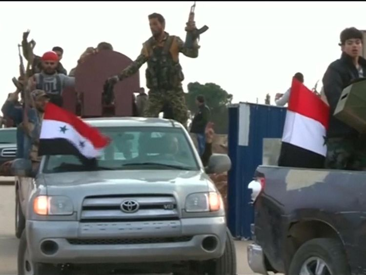 Syrian television played these images showing troops crossing a checkpoint