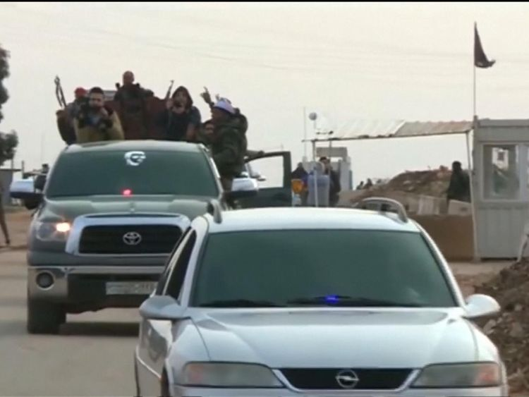 The troops cross a checkpoint in Afrin