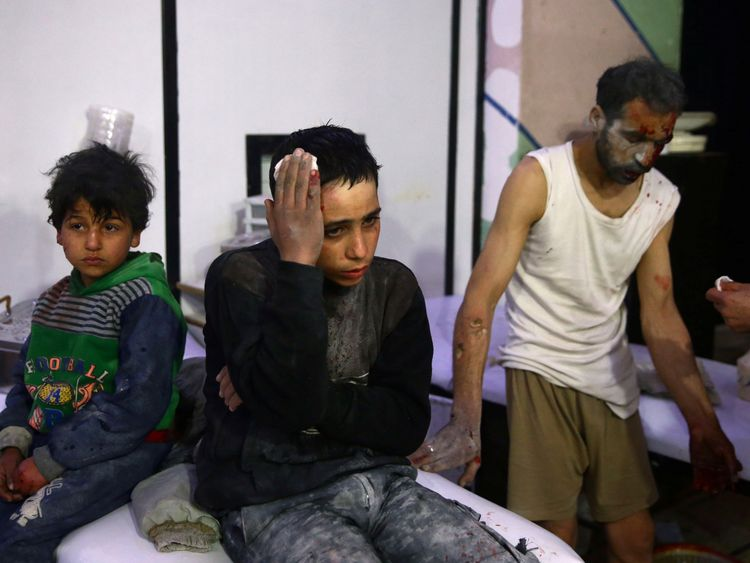 Wounded children and a man in a hospital in the besieged town of Douma, eastern Ghouta