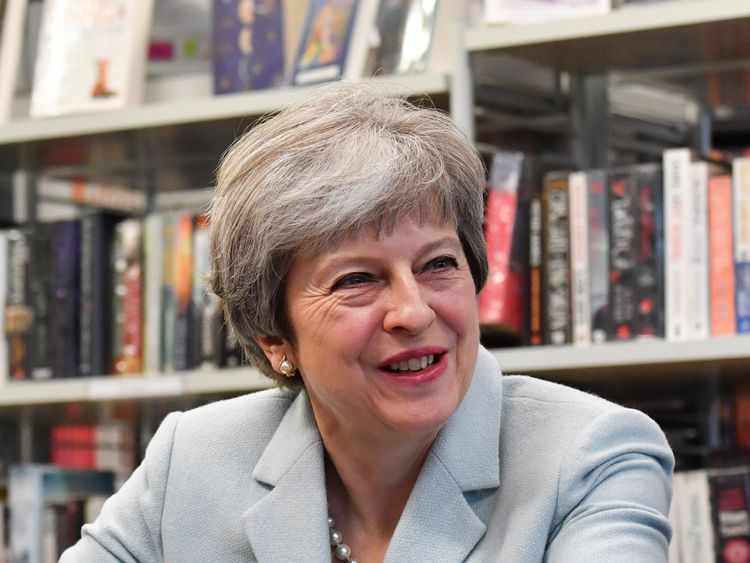 Theresa May talks with pupils and staff during her visit to Featherstone High School in Southall