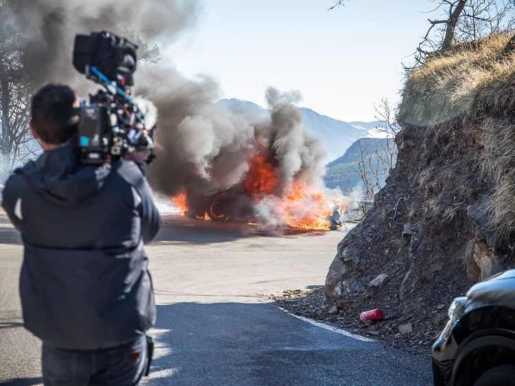 The crew film the blazing car
