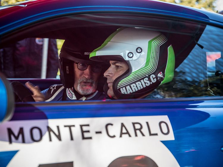 Chris Harris,right, and Eddie Jordan in the car before it burst into flame