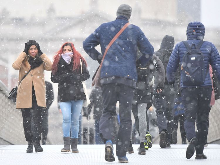 Commuters brave the cold weather on the Millennium Bridge in London