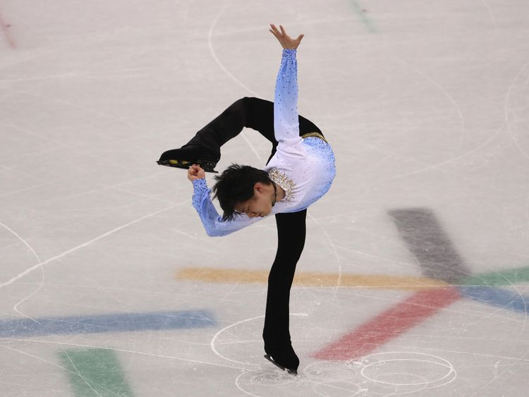 Figure skating-Chen leads after historic performance, Hanyu, Fernandez still to skate