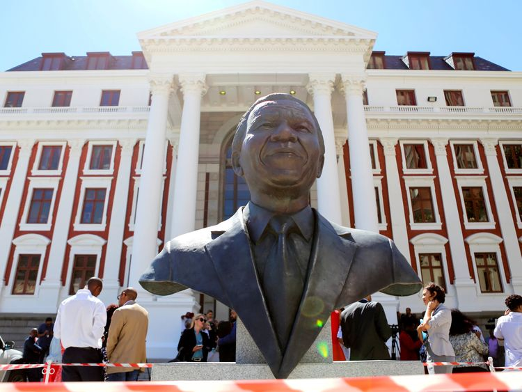 SAFRICA-POLITICS/RTX4REE26 Feb. 2018Cape Town, South AfricaMembers of the media are seen behind a bust of Nelson Mandela outside Parliament after it was announced that the State of the Nation address, due to be delivered by President Jacob Zuma, has been postponed, in Cape Town, South Africa, February 6, 2018. REUTERS/Sumaya Hisham TPX IMAGES OF THE DAY