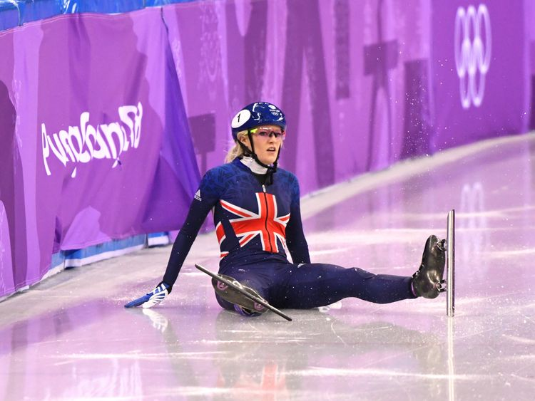 Elise Christie looks on after crashing out of the 500m short track final