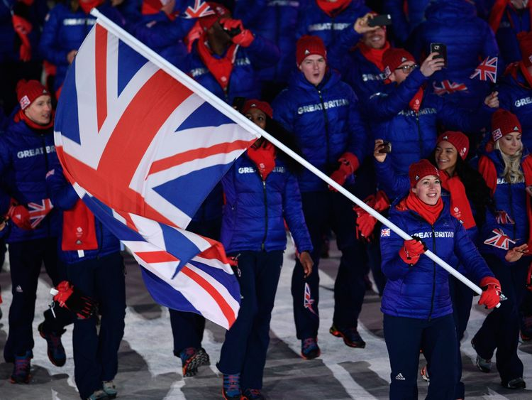 Lizzy Yarnold carries the flag for the Great Britain team at the opening ceremony