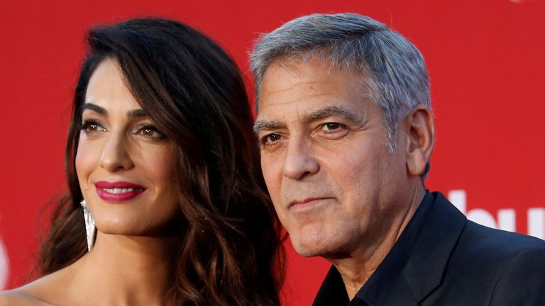 George and Amal Clooney have donated $500,000 to the Never Again movement