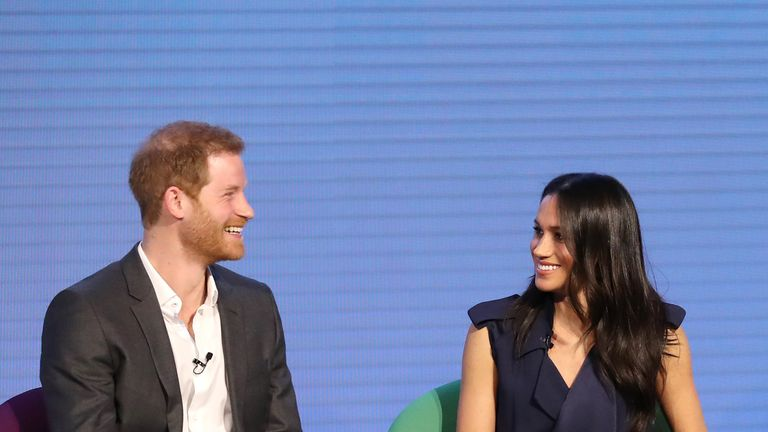 Meghan Markle and Prince Harry enjoy a joke together at the event