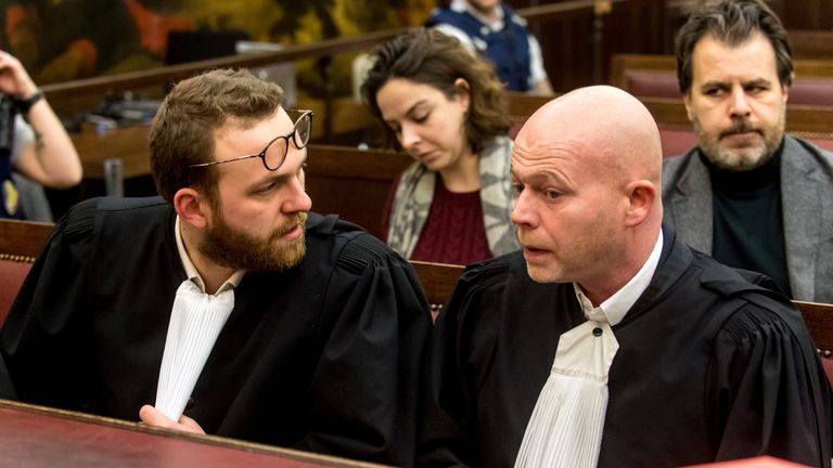 Belgian lawyers representing Paris attacks suspect Salah Abdeslam Sven Mary (R) and Romain Delcoigne speak together