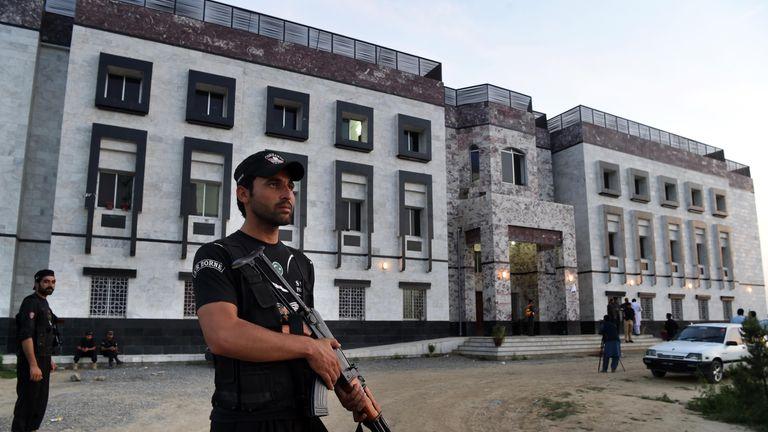 A policeman outside Abdul Wali Khan university