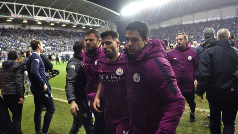 Sergio Aguero is led from the pitch by Manchester City assistant coach Mikel Arteta
