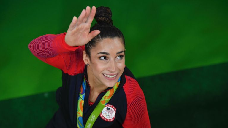 US gymnast Alexandra Raisman celebrates with her silver medal after the women's individual all-around final of the Artistic Gymnastics at the Olympic Arena during the Rio 2016 Olympic Games in Rio de Janeiro on August 11, 2016