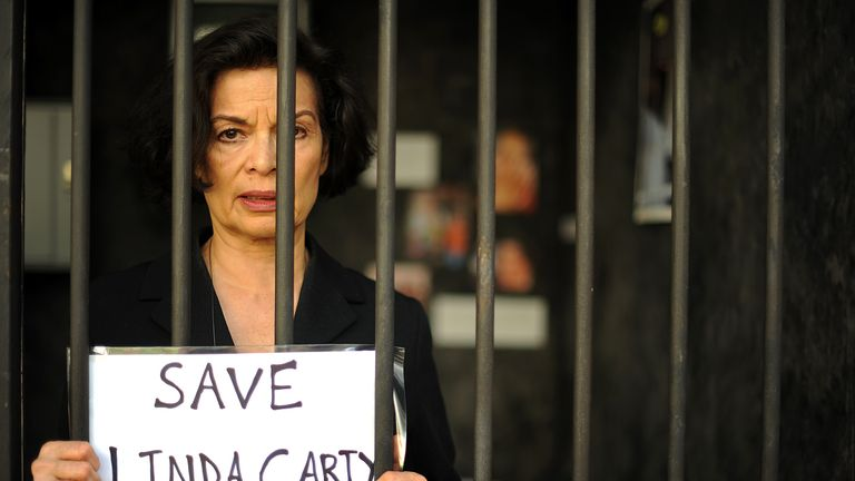 Human rights campaigner Bianca Jagger poses for photographers in a mock prison cell in London on September 7, 2010. The charity Reprieve has created a life-size death row cell to highlight the plight of British prisoner, Linda Carty who is on death row in the U.S after she was convicted for committing a murder on May 16, 2001. AFP PHOTO / BEN STANSALL (Photo credit should read BEN STANSALL/AFP/Getty Images)