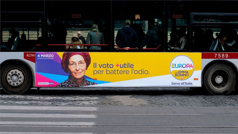 An election poster for the Europa party is seen on the side of a bus in Rome