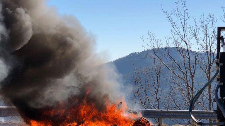 Car burst into flames. Pic: BBC