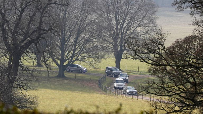 Official government cars make their way through the grounds of Chequers