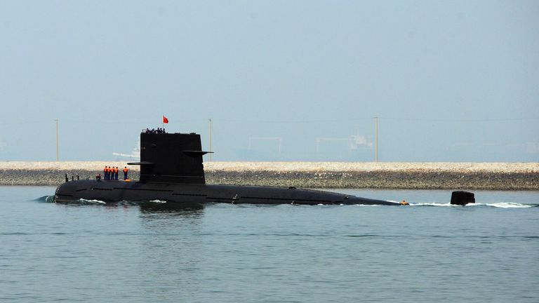 QINGDAO, CHINA - APRIL 22: A Chinese navy submarine leaves Qingdao Port on April 22, 2009 in Qingdao of Shandong Province, China. China's navy is set to hold a huge maritime ceremony to mark its 60 years of the Chinese navy and has invited ships and top officials from dozens of countries to attend. (Photo by Guang Niu/Pool/Getty Images)