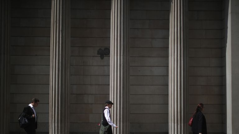 City workers talk on their mobile phones near the Bank of England as the financial markets face uncertainty in the wake of Brexit on June 27, 2016 in London, England. Earlier today Chancellor George Osborne said that contingency plans were in place to shore up the economy amid ongoing market volatility after Britain's vote to exit the European Union.
