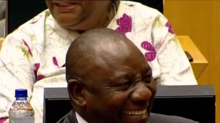 Cyril Ramaphosa smiles after he is named the country's new president