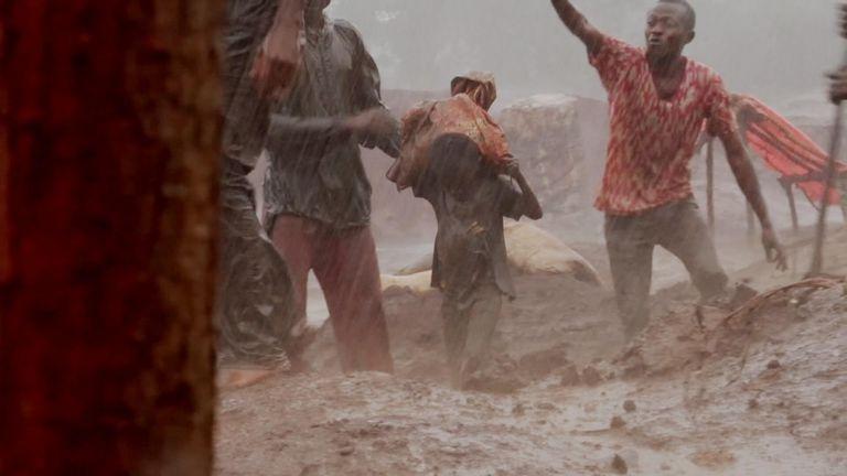 Eight-year-old Dorsen working in an African cobalt mine
